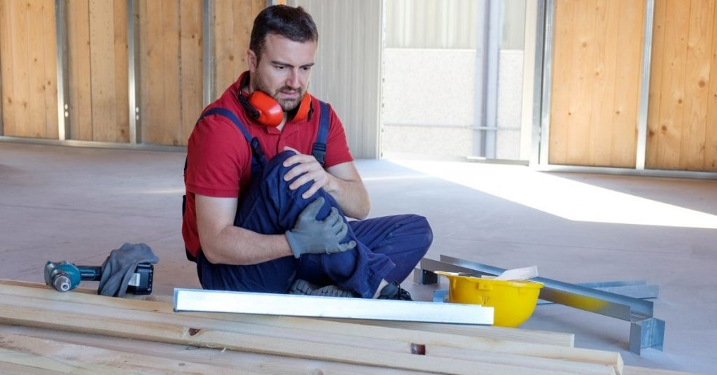 knee injured construction male worker