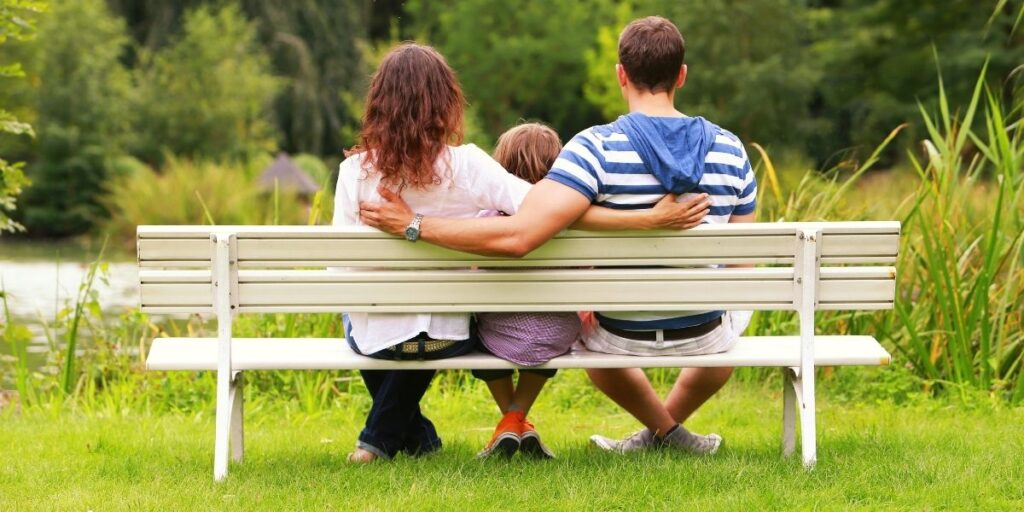 family sitting on a bench