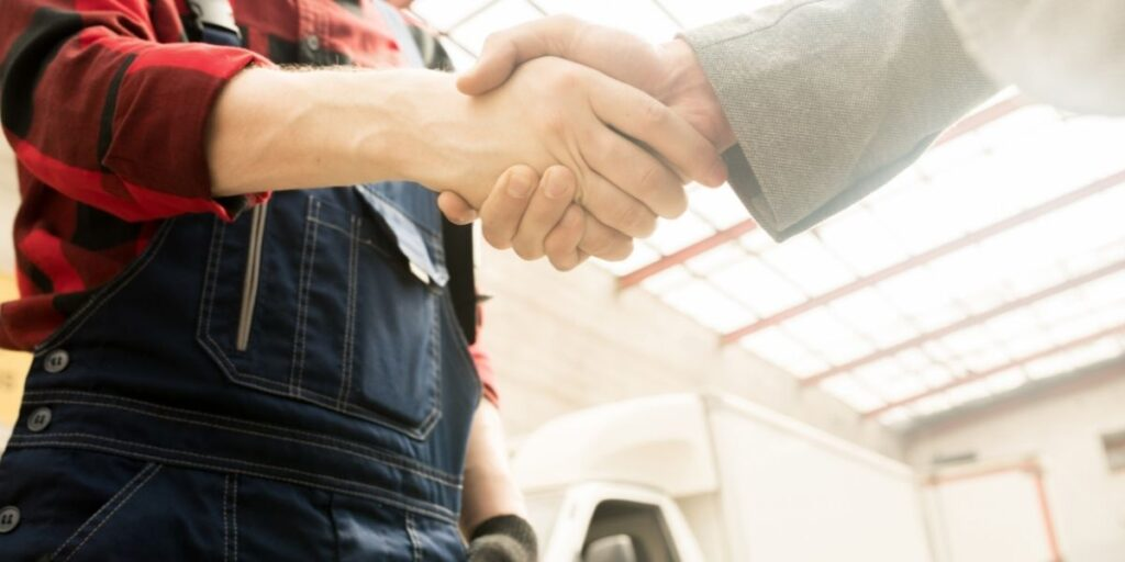 worker handshake with lawyer