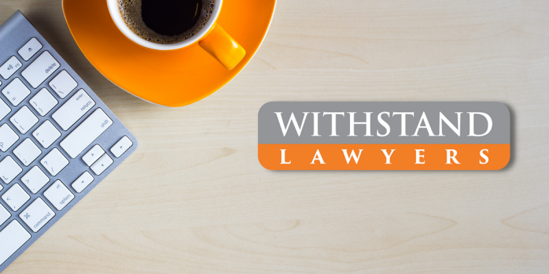 Withstand lawyers logo on a desk